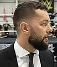 WWE_Superstar_FINN_BALOR_joins_MOUSTACHE_MOUNTAIN_at_the_opening_of_the_NXT_UK_PC_143.jpg